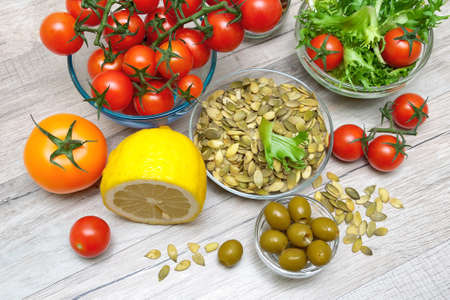 ingredients for preparation of vegetable salad on a wooden background. horizontal photo. Stock Photo