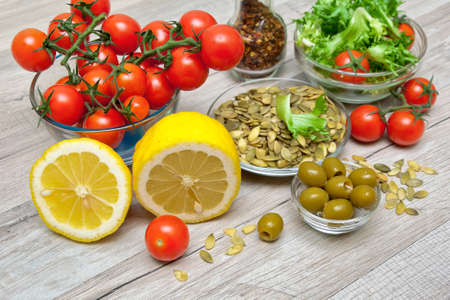 fresh food to cook vegetable salad on a wooden background. horizontal photo. Stock Photo