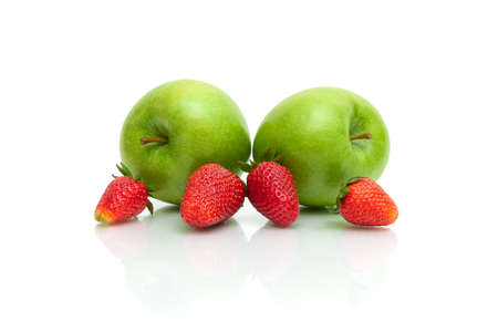Ripe strawberries and green apples on a white background. horizontal photo.