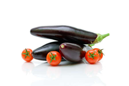 tomatoes and eggplant on a white background. horizontal photo.