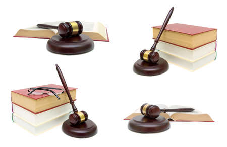 judicial proceeding: Wooden judge hammer and book on white background. Horizontal photo. Stock Photo