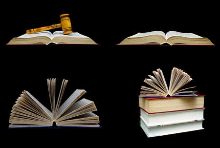 Books and a wooden hammer of the judge on a black background. Horizontal photo.