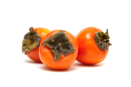 ripe persimmon isolated on white background. horizontal photo. 스톡 콘텐츠