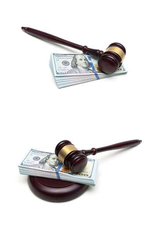 money and a wooden judge hammer on a white background. vertical photo.