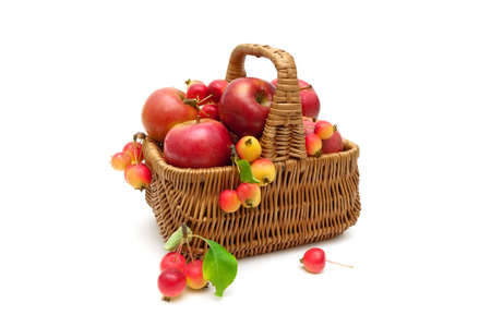 basket with apples on a white background. horizontal photo.