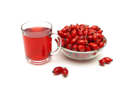 Rose hips and a drink on a white Stock Photo