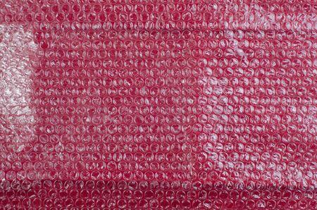 polyethylene film: Film with air bubbles on a red background