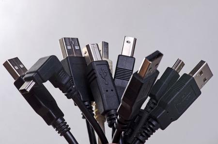 bonded: A stack of black usb plugs bonded together