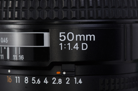50mm: Macro photo of the lens of 50 mm side inscription Stock Photo