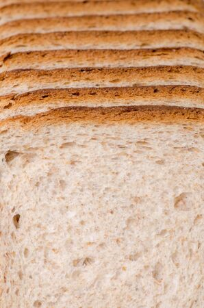 multi grain sandwich: sliced bread on a board on a white background