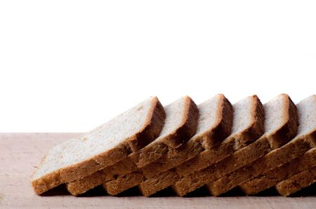 whole wheat toast: sliced bread on a board on a white background
