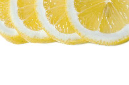 Lemon ring sliced macro on white background