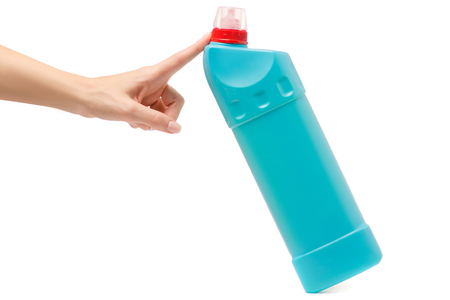 Bottle with toilet detergent household chemicals in a female hand on a white background isolation