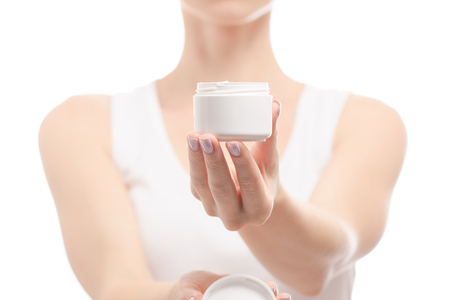 Woman female hands holding hand cream on white background isolation