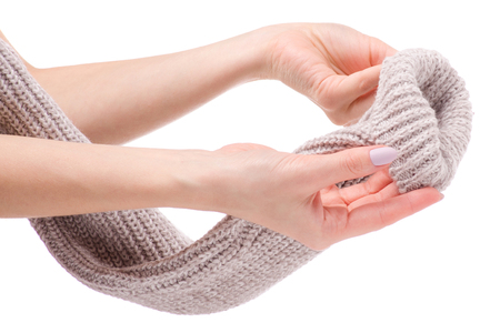 Warm sweater beige female hand on a white background isolation