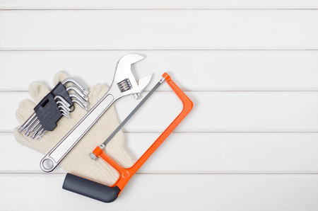 Tools laid out on a white wooden background