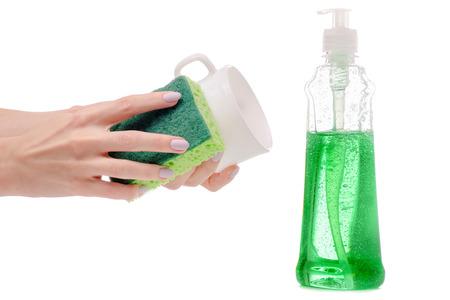 Dishwashing bottle sponge and dishes female hand isolated on white background.