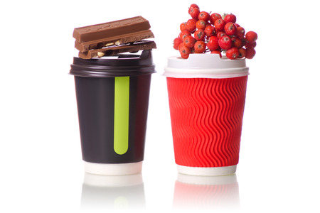 Two cardboard coffee cups chocolate sprig of viburnum mountain ash on white background isolation