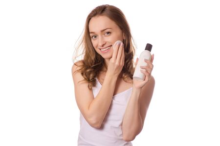 Beautiful young woman tonic micellar water gel for face washing cotton pads on white background isolation Stock Photo
