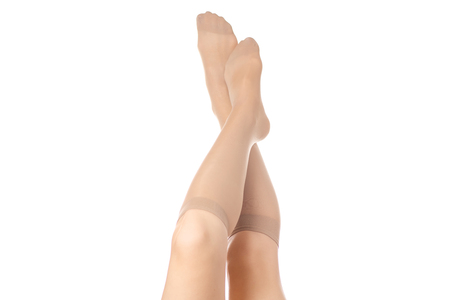 Female legs in socks stockings isolated on white background isolation