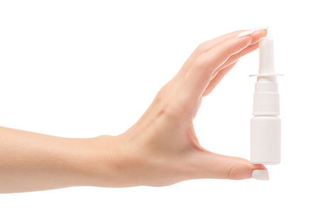 Female hands medicine nose spray on white background isolation Stock Photo