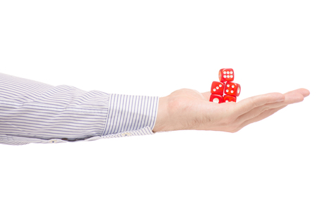 Male hands dice on a white background isolation Stock Photo