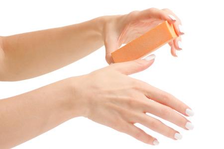 Female hand manicure nail buff on white background isolation