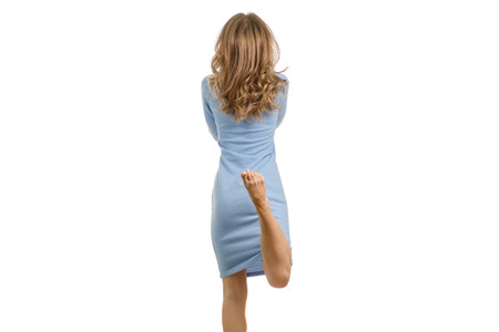 Young woman in dress rear view on white background isolation Foto de archivo