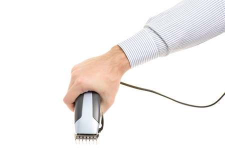 Male hand with a clip-on hair on white background isolation Stock Photo