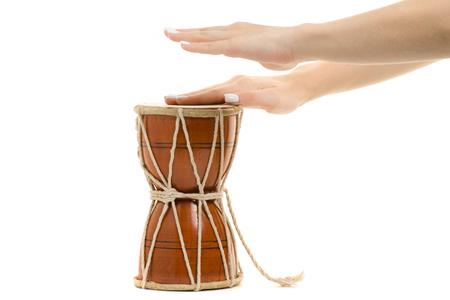 Female hands little drum on white background isolation Stock Photo