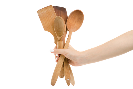Female hand kitchen spatula isolated on white background isolation