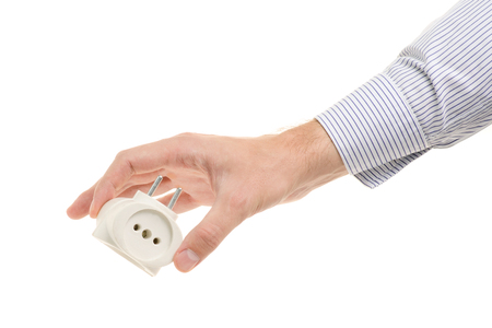 Male hand holding a tee in a white socket on a white background isolating Stock Photo