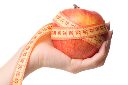 Apple centimeter in hand health losing weight on white background isolation
