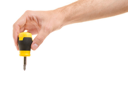 Screwdriver with replaceable nozzles in the hand on a white background isolation