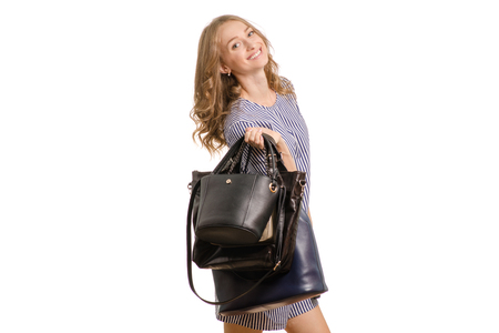 Beautiful young girl with ladies' handbags on white background isolation