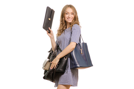 Beautiful young girl with ladies handbags on white background isolation Banco de Imagens