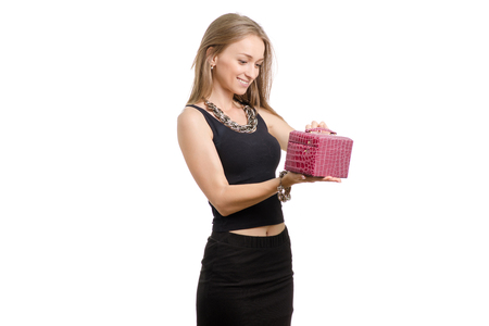 Beautiful young girl with box with decoration on white background isolation