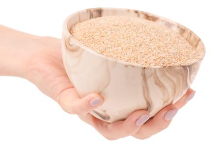 흰색 배경 격리에 밀 죽 기장 손 스톡 콘텐츠