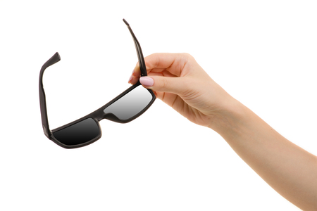 Black glasses in a female hand on a white background isolation Stock Photo
