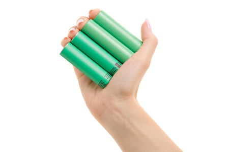 18650 batteries in a female hand on a white background isolation