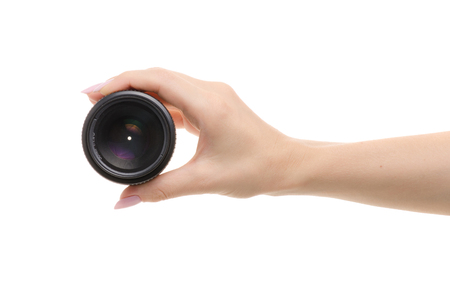 Lens on a camera in a female hand on a white background isolation