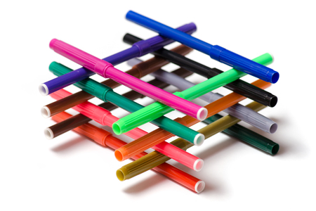 Multicolored markers folded in a well on a white background isolation Stock Photo