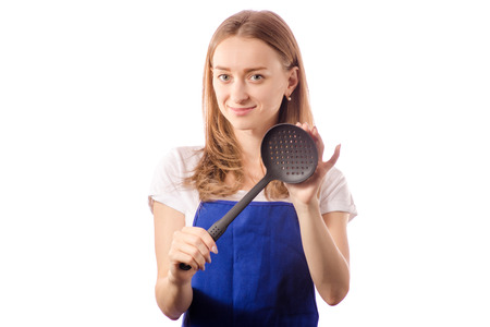 Young woman in apron with skimmer in hand on white background isolation Stock Photo