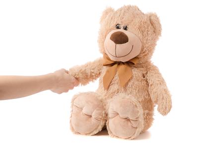 Soft toy beige bear hand on white background isolation Archivio Fotografico