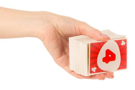 Playing cards in hand on white background isolation