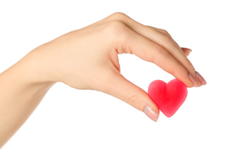 Jelly heart candy sweets in hand on white background isolation Stock Photo