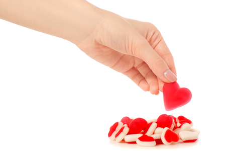 Jelly heart candies sweets in hand on white background isolation