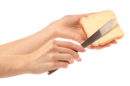 Bread with butter knife in hand on white background isolation