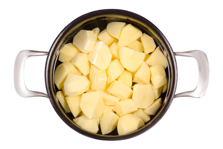 A pot of peeled potatoes on a white background isolation Stock Photo
