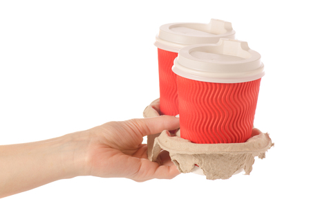 Cardboard stand for coffee in hand on a white background isolation